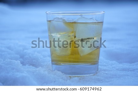 Glass of whiskey and ice on snow #609174962