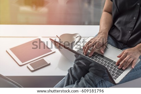 Digital communication lifestyle blog writer person using mobile smart device, or woman user typing on computer laptop working online via wireless internet technology, work from home  Royalty-Free Stock Photo #609181796