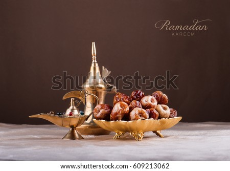 Ramadan kareem with premium dates and arabic coffee mug Royalty-Free Stock Photo #609213062