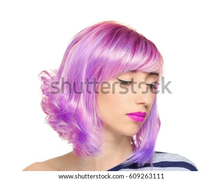 Beautiful young woman with dyed hair on white background #609263111