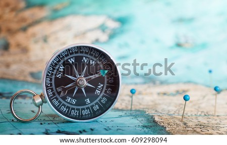 Compass on map.  Royalty-Free Stock Photo #609298094
