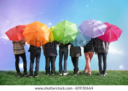 seven friends with rainbow color umbrellas on meadow collage #60930664