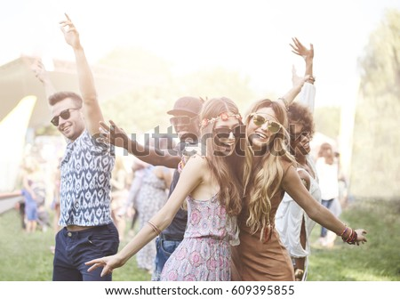 Enthusiastic crowd surfing at music festival  Royalty-Free Stock Photo #609395855