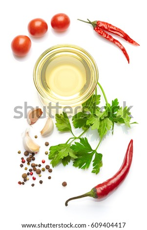 Mediterranean food and drink healthy lifestyle concept: Italian herbs vegetables and spices. Top view. Isolated on white. Olive oil Cherry tomatoes parsley garlic and peppers. #609404417