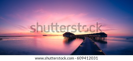 Amazing panorama beach landscape. Maldives sunset seascape view. Horizon with sea and sky. Tranquil scenery, tourism and travel banner Royalty-Free Stock Photo #609412031