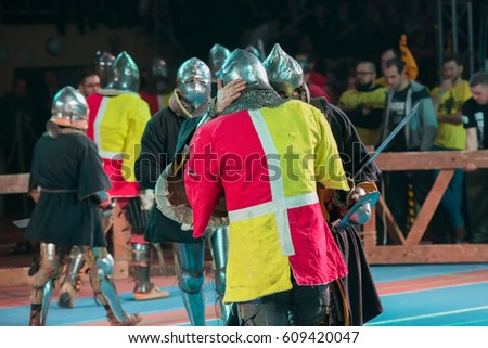 "MOSCOW - DECEMBER 03, 2016: Armored fighters , dressed as knights, fighting at the XI World championship in Medieval combat CUP ""DYNAMO"". in the Olympic Center. Znamensky #609420047"