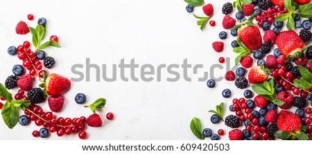 Various fresh summer berries. Top view #609420503