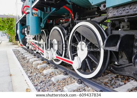 Train wheel of a steam locomotive tourist attraction Bangkok Thailand  #609437834