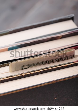 Folded banknotes hidden in books #609464942