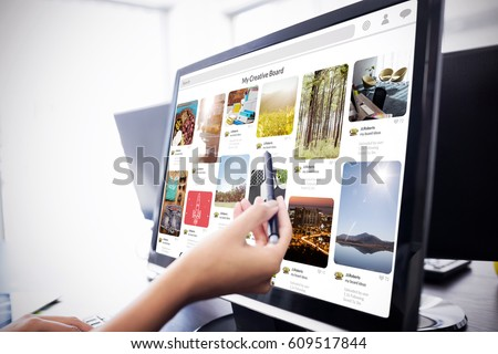 Composite image of website page against casual businesswoman touching her computer Casual businesswoman touching her computer with a pen #609517844