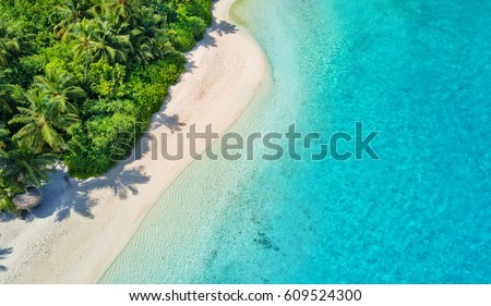 Aerial photo of beautiful paradise Maldives tropical beach on island. Summer and travel vacation concept. #609524300