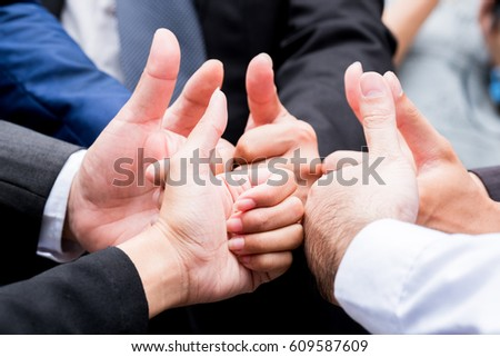 Businessmen showing thumbs up - closeup shot,Successful thumbs up after good deal. businessman thumbs up. #609587609