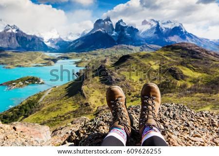 Girl hiking boots having fun and enjoying wonderful breathtaking mountain view. Freedom concept. Los Cuernos rocks, Patagonia, Chile Royalty-Free Stock Photo #609626255
