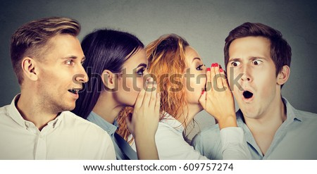 Group of young people men and women whispering each other in the ear. Word of mouth concept  Royalty-Free Stock Photo #609757274