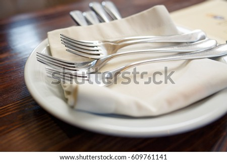 Close up image of forks and knives served on the table in restaurant. Cutlery background #609761141