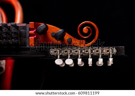 nyckelharpa's scroll, headstock and pegbox details, concept of folk, baroque and classical music played with handcrafted ancient string musical instruments #609811199