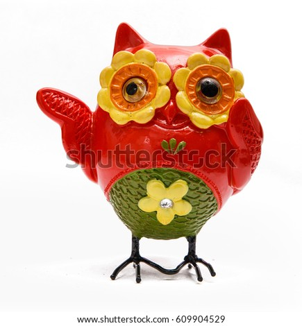 Toy Owl. Standing, Red Green and Yellow, Open Wing, Isolated on White