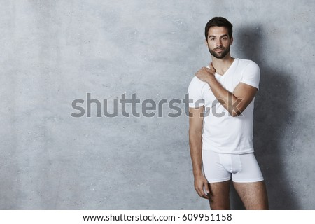 T-shirt and shorts guy in grey studio #609951158