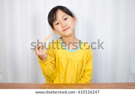 A girl with chopsticks #610126247