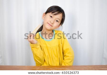 A girl with chopsticks #610126373