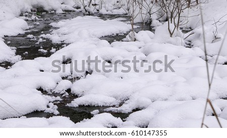 Creek in the snow   #610147355