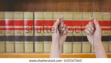 Digital composite of mans hands holding glass tablet in Library #610167665