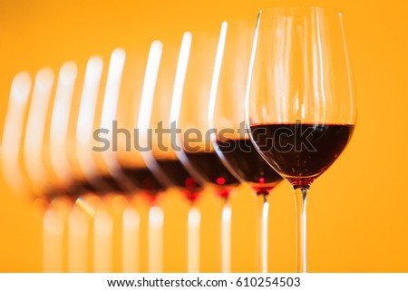 Many glasses of different wine in a row on bar counter #610254503