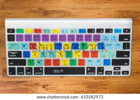 Special keyboard for Graphic Designer or Photographer, isolated with clipping path on wood desk background  #610282973