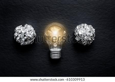 concept of idea illustration lit lamp on black background #610309913
