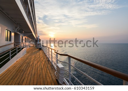 Luxury Cruise Ship Deck at Sunset. Royalty-Free Stock Photo #610343159