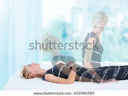 Digital composite of Woman Meditating astral projection out of body experience by window Royalty-Free Stock Photo #610386983