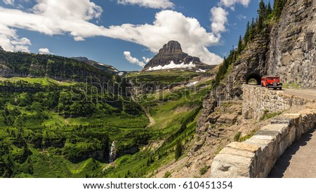 Beautiful view of Glacier National Park belong Going to the sun road with the iconic red car #610451354