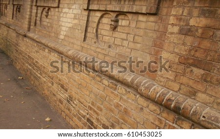 The foundation of the old brick house of yellow-brown color #610453025
