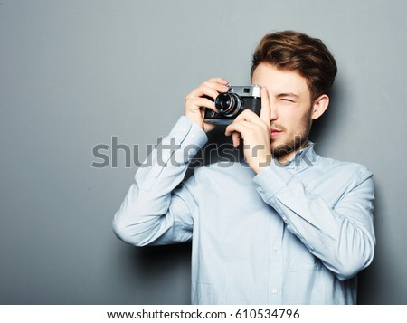 Handsome young man looking at camera  #610534796