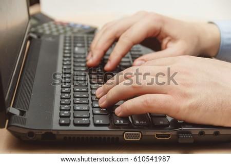 businessman hand using keyboard on computer laptop #610541987