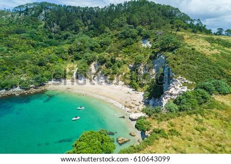 Aerial of Te Whanganui-A-Hei (Cathedral Cove) Marine Reserve in Coromandel Peninsula North Island, New Zealand. Royalty-Free Stock Photo #610643099