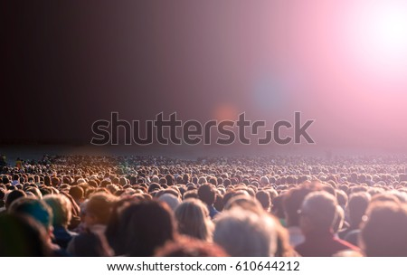 Panoramic photo of large crowd of people. Slow shutter speed motion blur. #610644212