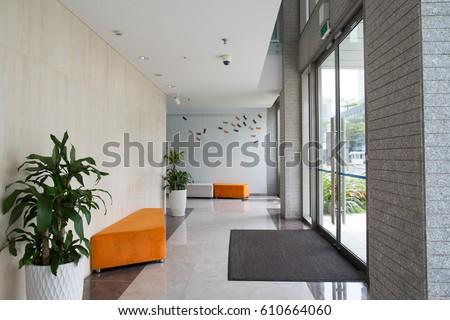 Condominium building entrance Royalty-Free Stock Photo #610664060