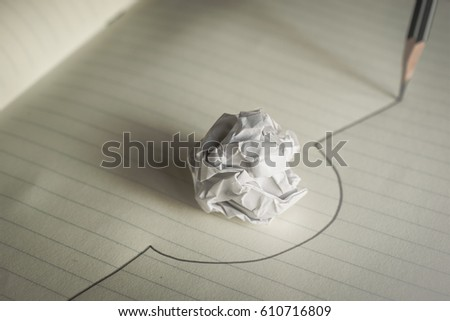 Pencil drawn line avoid a crumpled paper ball avoid mistakes concept. Royalty-Free Stock Photo #610716809