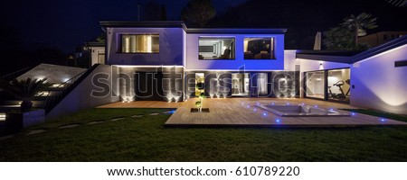 House with pool in the evening #610789220