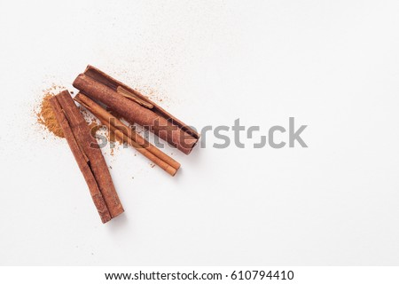 Cinnamon sticks in the recipes of cosmetics and cooking, folk medicine Royalty-Free Stock Photo #610794410