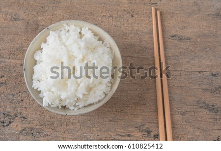Rice in old cups and chopsticks #610825412
