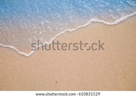 Soft wave on sandy beach. Background.Summer background concept. #610831529