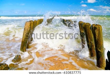 Splashes of waves on shore #610837775