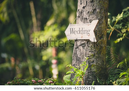 Soft focus vintage wedding sign. Handmade wooden board with the inscription Wedding #611055176