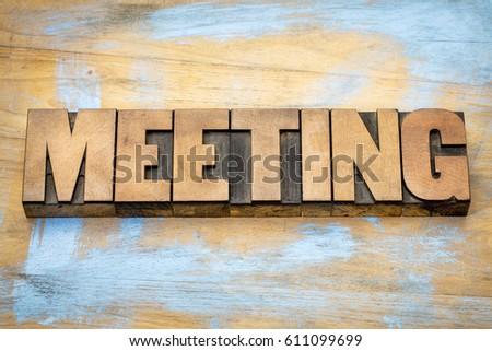 meeting word in letterpress wood type against grunge wooden background #611099699