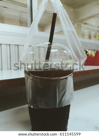 ice tea black coffee in plastic cup with straw drinking breaking time in office  #611145599