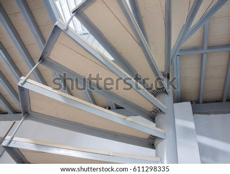 Spiral staircase inside house of construction. #611298335