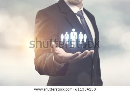 Business man holding opinion leader, team leader, market leader, Leading concepts. #611334158