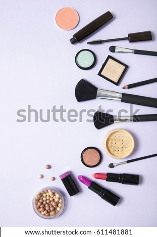 A collection of make up and cosmetic beauty products arranged on a pale purple background #611481881
